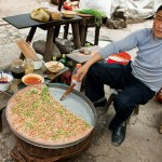 Taro cake seller in Rongjiang